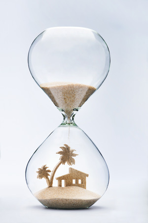 sand: Summer accomodation concept with falling sand taking the shape of a house and palm tree