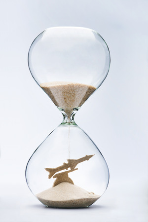 disarm: War time. Hourglass falling sand taking the shape of a launching missile