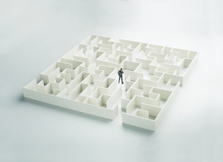 business challenge: Business challenge. A businessman navigating through a maze. Rear view Stock Photo