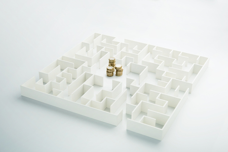 finding love: The uncertainty of money and business. Coins stack hidden inside a maze