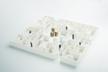 loveheart: The uncertainty of money and business. Coins stack hidden inside a maze