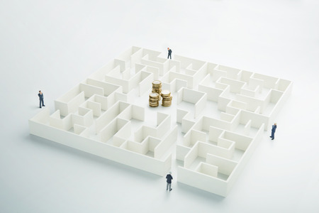 complicated journey: The uncertainty of money and business. Coins stack hidden inside a maze
