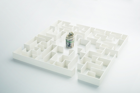 european money: The uncertainty of money and business. Dollar banknotes hidden inside a maze Stock Photo
