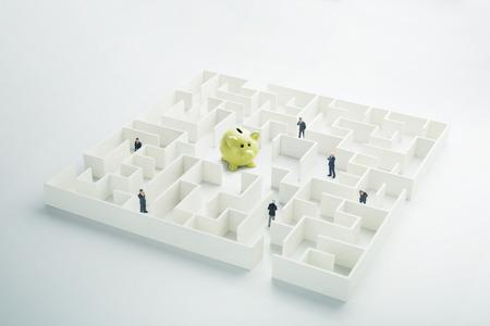 finding love: The uncertainty of money and business. Piggy bank hidden inside a maze