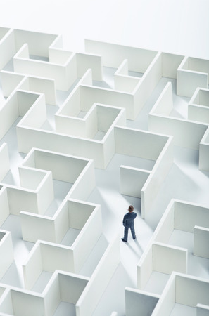 Business challenge. A businessman navigating through a maze. Top view