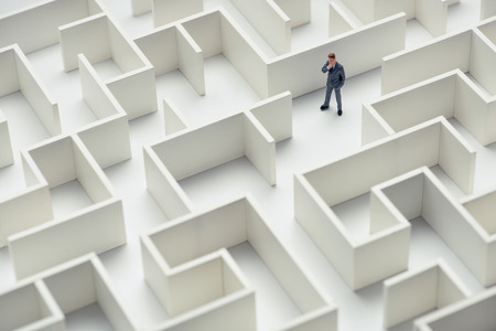new opportunity: Business challenge. A businessman navigating through a maze. Top view