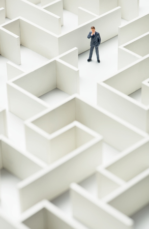 business challenge: Business challenge. A businessman navigating through a maze. Top view