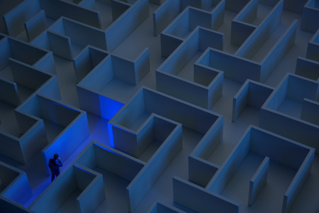 solved maze puzzle: Businessman with flashlight walking through maze