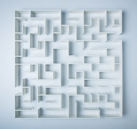 solved maze puzzle: Maze on white background concept for decision-making Stock Photo
