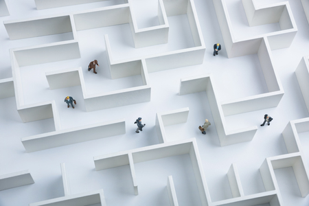 Business challenge. Businessmen navigating through a maze