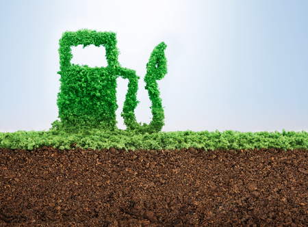 Green energy concept with grass growing in shape of fuel pump Stockfoto