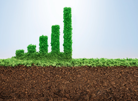 Business growth concept with grass growing in shape of graphic bar