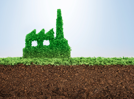 Sustainable industrial development concept with grass growing in shape of factory