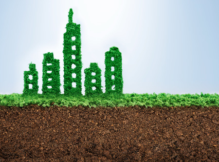 green building: Sustainable urban development concept with grass growing in shape of a city