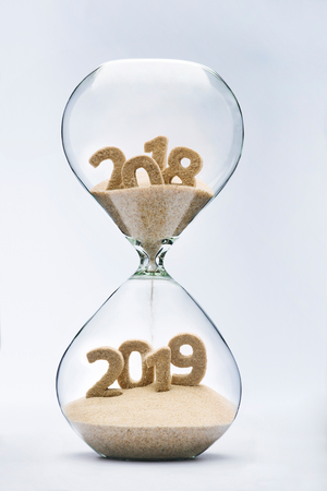 New Year 2019 concept with hourglass falling sand taking the shape of a 2019