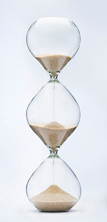 Past, present and future concept. Falling sand in a 3 part hourglass. Infinity.