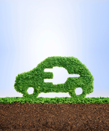 Grass growing in the shape of a car with a cut out plug, symbolising the need to invest in alternative fuel solutions.