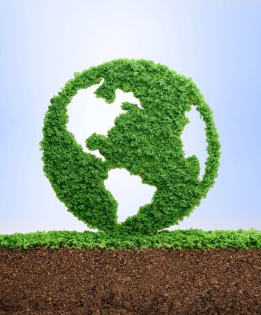 Grass growing in the shape of planet Earth, symbolising the need to protect the environment and reconnect with nature. Stock Photo