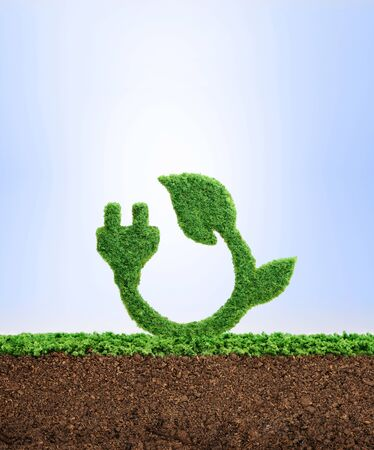 Grass growing in the shape of a plug and a leaf, symbolising the need to protect the environment and reconnect with nature. Stock Photo
