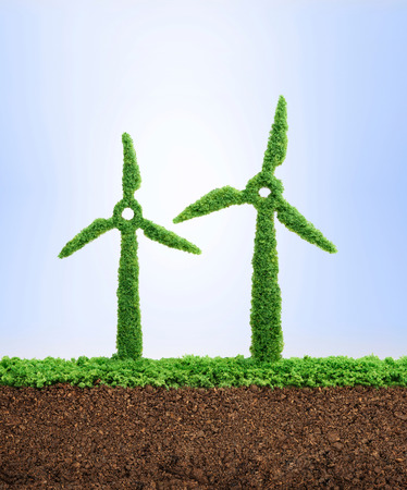 Grass growing in the shape of two wind turbines, symbolising the need to protect the environment and reconnect with nature. Stock Photo