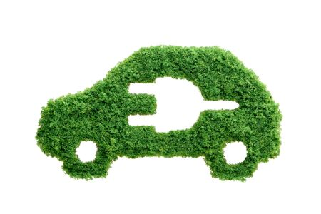 Grass growing in the shape of a car with a cut out plug. Invest in alternative fuel solutions concept.