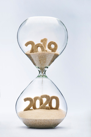 New Year 2020 concept with hourglass falling sand taking the shape of a 2020 版權商用圖片 - 103852316