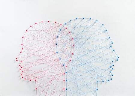 Couple community concept. Network of pins and threads in the shape of two heads mearging symbolising a deep connection relationship. Reklamní fotografie