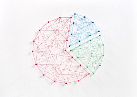 Network of pins and threads in the shape of a business pie graphic chart symbolising business planning through collaboration. Reklamní fotografie