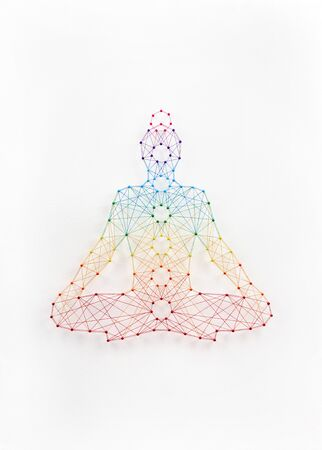 Network of pins and threads forming yoga lotus pose symbolising connection to inner self. Reklamní fotografie
