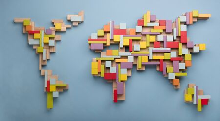 Top view on world global map made of colorful wooden bricks. World unity, diversity and education concept. Фото со стока