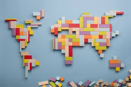 Top view on world global map made of wooden bricks. World unity, diversity and education concept.
