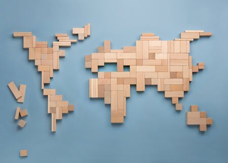 World map made from wooden toy blocks. Top view on world global map made of colorful wooden bricks. World unity, diversity and education concept. Фото со стока