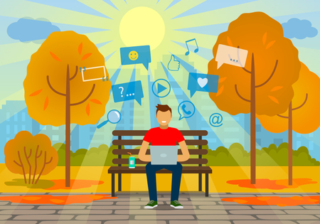 designer: A young man on the bench with friends in the autumn. The concept of modern man.