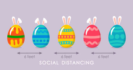 cute colorful easter eggs with bath bunny ears and ornaments during the coronavirus epidemic