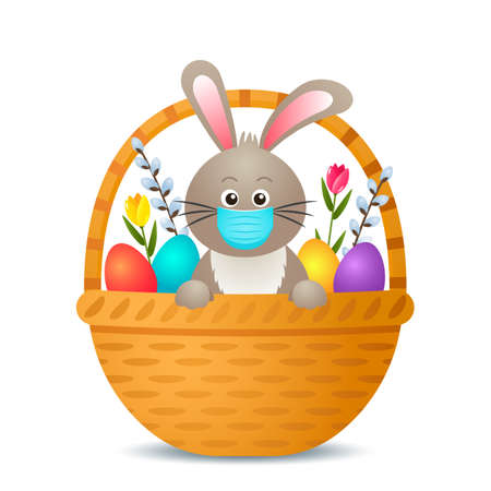 Easter bunny in a medical mask with Easter eggs and flowers in a basket.