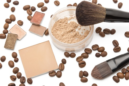 visagiste: Powder and eyeshadow beige shades with scattered coffee beans