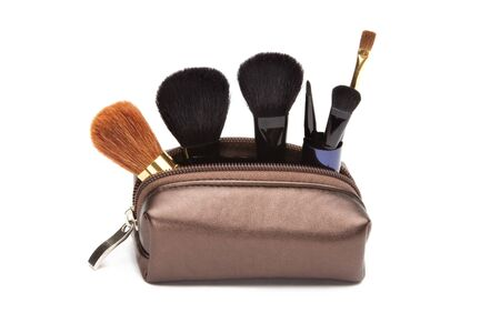 visagiste: Makeup case with brushes isolated on white