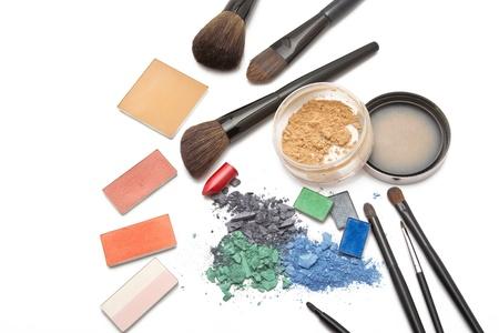 visagiste: Eye shadow, lipstick, powder, blush and brushes on makeup artist table