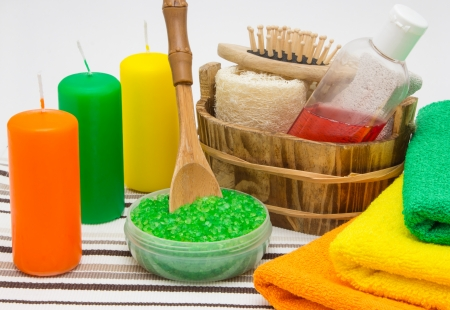 orange washcloth: Candles, sea salt, shower gel with towels and other bathroom accessories