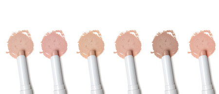 concealer: Different tones of makeup concealer pencil on white background Stock Photo