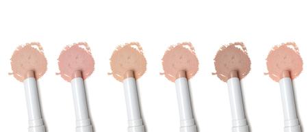 Different tones of makeup concealer pencil on white background Standard-Bild