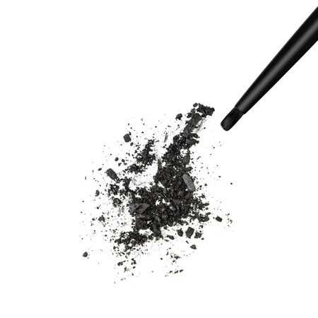 shimmery: Closeup of crushed black shimmery eyeshadow with makeup brush on white background