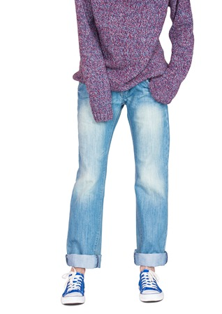 baggy: Girl dressed in straight wide leg jeans, baggy sweater and sneakers, cropped below the shoulders on white background