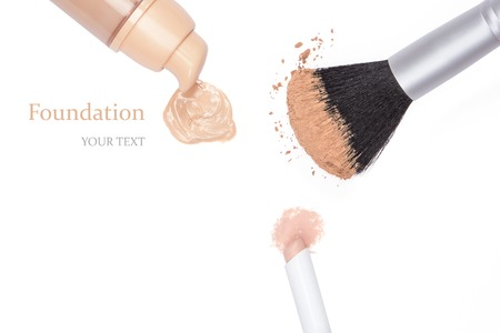 concealer: Closeup of foundation with open jar, concealer pencil and loose cosmetic powder on makeup brush on white background Stock Photo
