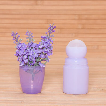 Body antiperspirant deodorant roll-on with lilac flowers in the cap