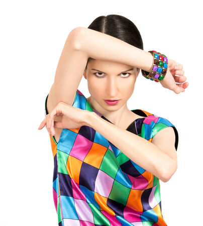 sullenly: Beautiful fashion woman dressed in colorful checkered dress and bracelet posing on white background