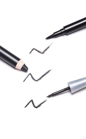 Different kinds of black eyeliners on white background