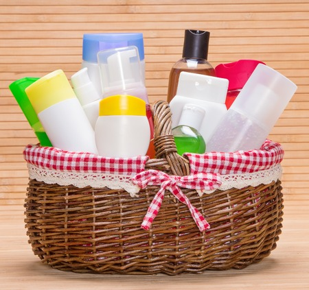 Wicker basket filled with different cosmetic products for body care