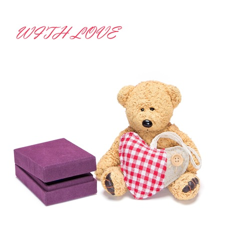Cute teddy bear with fabric heart sitting next to gift box for jewelry on white background photo