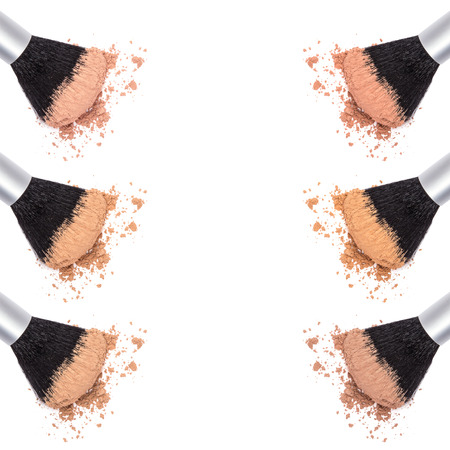 Different shades of loose cosmetic powder on white background, top view. Two sided frame. Space for text in the center Stock Photo